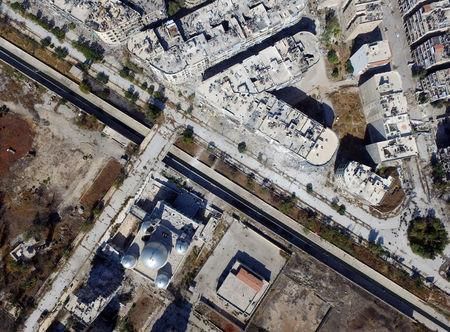 A general view taken with a drone shows a road separating Aleppo's government-controlled areas from the rebel-held ones in Syria October 20, 2016. REUTERS/Abdalrhman Ismail