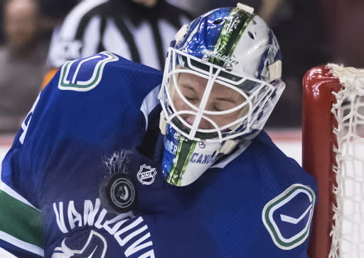 Vancouver Canucks goalie Jacob Markstrom, of Sweden, stops a shot by the New York Rangers during the third period of an NHL hockey game Wednesday, March 13, 2019, in Vancouver, British Columbia. (Darryl Dyck/The Canadian Press via AP)