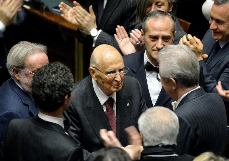 Italy's Former President Giorgio Napolitano (C) is welcomed by former Prime Minister Mario Monti (R) as he arrives in the Parliament in Rome on January 29, 2015