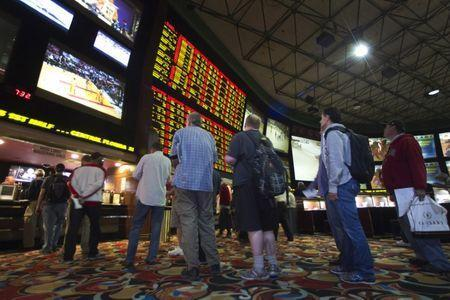 People wait in line to place bets after Super Bowl XLVIII proposition bets were posted at the Las Vegas Hotel & Casino Superbook in Las Vegas, Nevada January 23, 2014. REUTERS/Las Vegas Sun/Steve Marcus