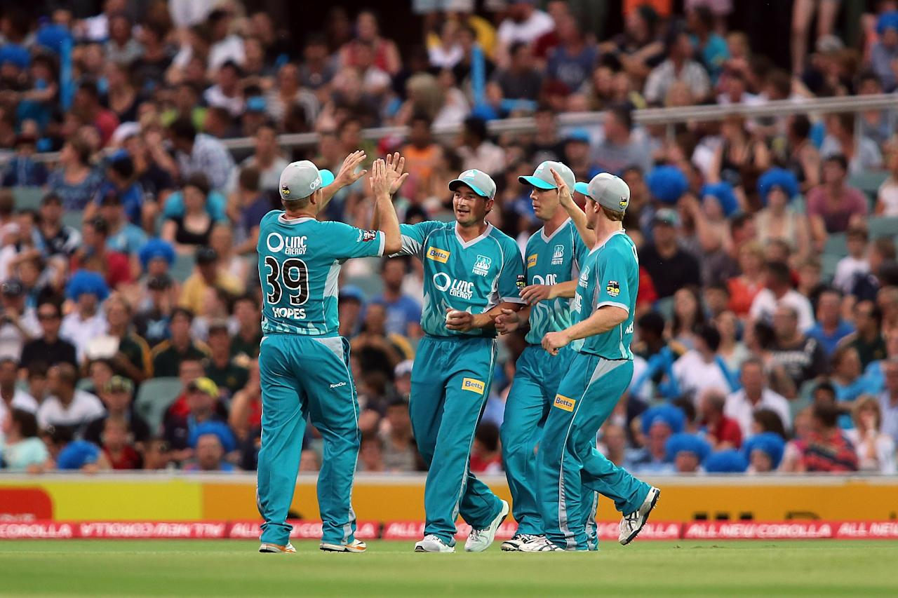 ADELAIDE, AUSTRALIA - DECEMBER 13: Heat players celebrate after getting the wicket of Callum Ferguson of the Strikers during the Big Bash League match between the Adelaide Strikers and the Brisbane Heat at Adelaide Oval on December 13, 2012 in Adelaide, Australia.  (Photo by Morne de Klerk/Getty Images)