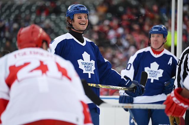 DETROIT, MI - DECEMBER 31: Mike Krushelnyski #26 of the Toronto Maple Leafs prepares to take a face off against the Detroit Red Wings in the first period during the 2013 Hockeytown Winter Festival Alumni Showdown on December 31, 2013 at Comerica Park in Detroit, Michigan. (Photo by Jamie Sabau/Getty Images)
