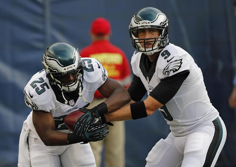 Philadelphia Eagles quarterback Nick Foles (9) hands off to running back LeSean McCoy as Eagles warm up for an NFL preseason football game against the Chicago Bears on Friday, Aug. 8, 2014, in Chicago