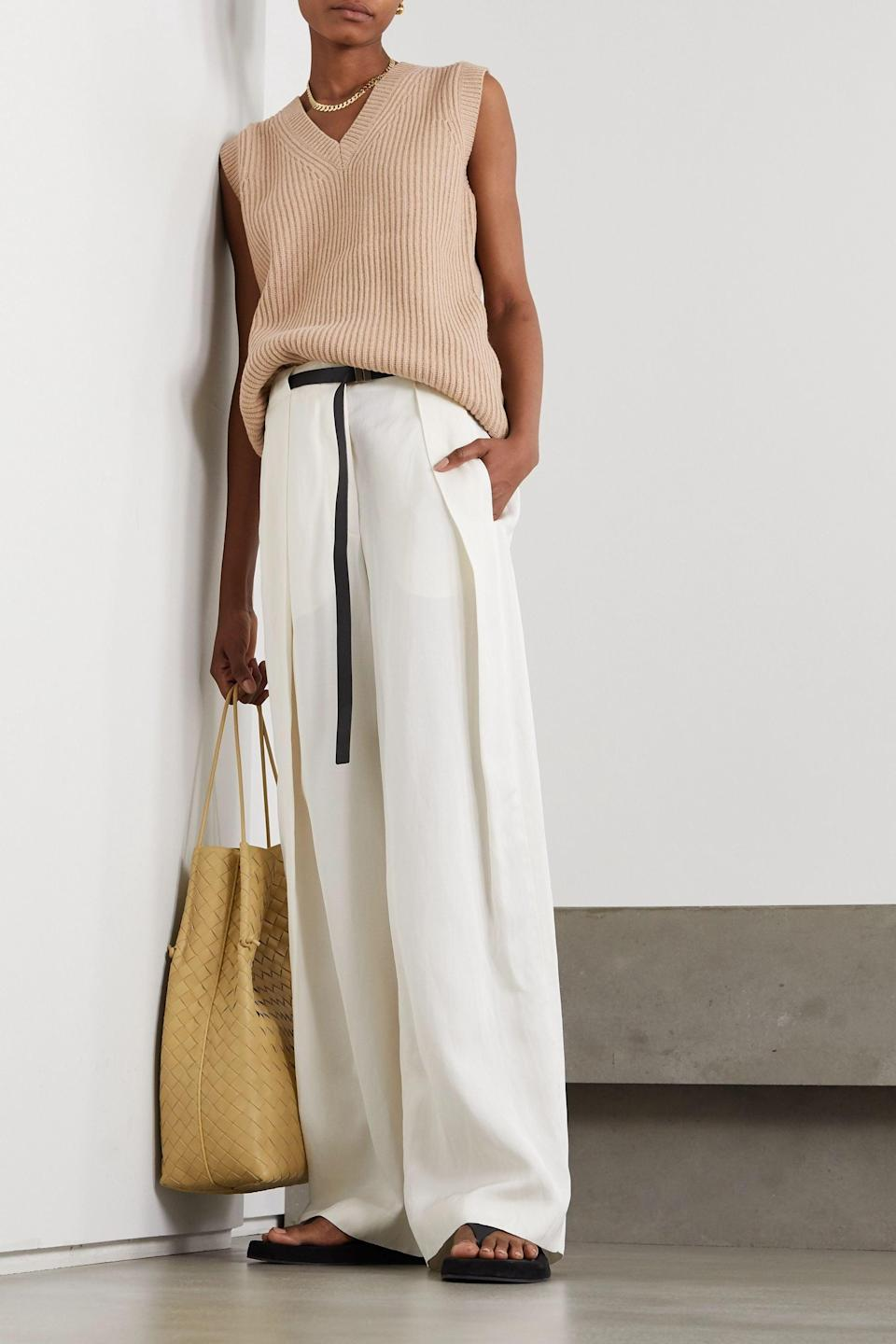 <p>Wear this <span>Joseph Beige Ribbed wool sweater</span> ($475) on its own or over a long-sleeve shirt.</p>
