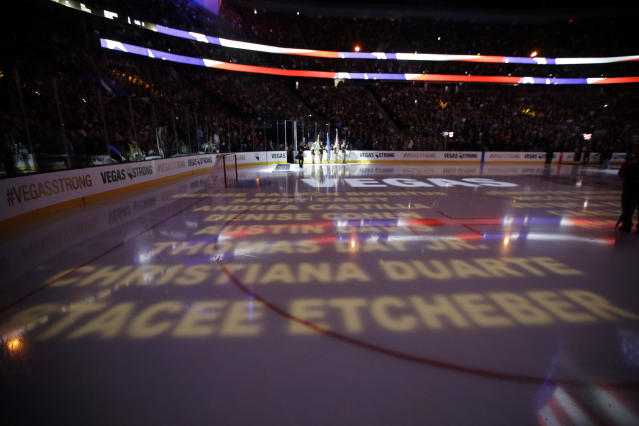 Names of victims of the mass shooting in Las Vegas are projected on the ice before an NHL hockey game between the Vegas Golden Knights and the Arizona Coyotes, Tuesday, Oct. 10, 2017, in Las Vegas. (AP Photo/John Locher)