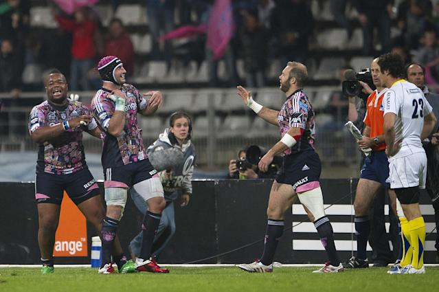 (FromL) Stade Francais' Mathieu Bastareaud, Juan Leguizamon and Ollie Phillips celebrate at the final whistle of the European Challenge Cup semi final rugby union match Stade Francais vs. Clermont at the Charlety stadium in Paris on April 29, 2011. AFP PHOTO / BERTRAND LANGLOIS (Photo credit should read BERTRAND LANGLOIS/AFP/Getty Images)