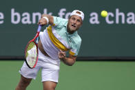 Denis Kudla, of the United States, serves to Alejandro Tabilo, of Chile, at the BNP Paribas Open tennis tournament Friday, Oct. 8, 2021, in Indian Wells, Calif. (AP Photo/Mark J. Terrill)