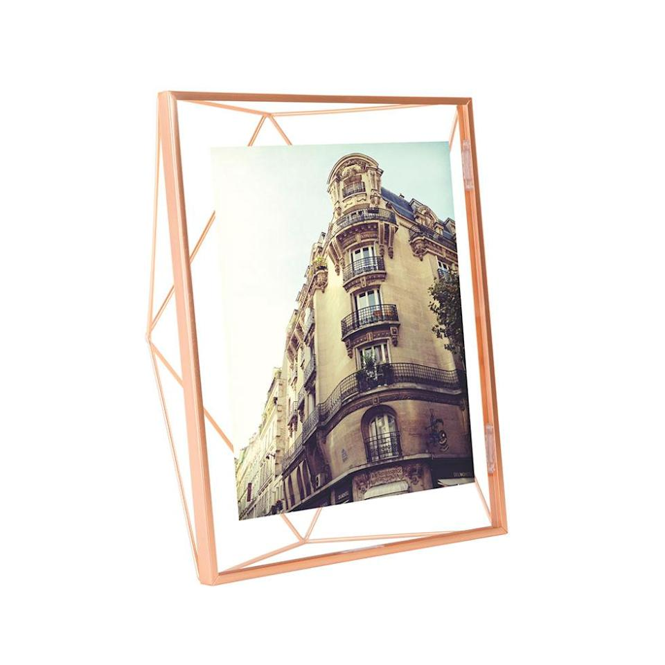 """<p>Scrambling for a last-minute present that'll guarantee a smile on her face? A favorite photo in an eye-catching frame ought to do the trick. ($25; <a href=""""http://www.umbra.com/usd/frames/table-top-frames/prisma-8x10-phot"""" rel=""""nofollow noopener"""" target=""""_blank"""" data-ylk=""""slk:umbra.com"""" class=""""link rapid-noclick-resp"""">umbra.com</a>)</p>"""