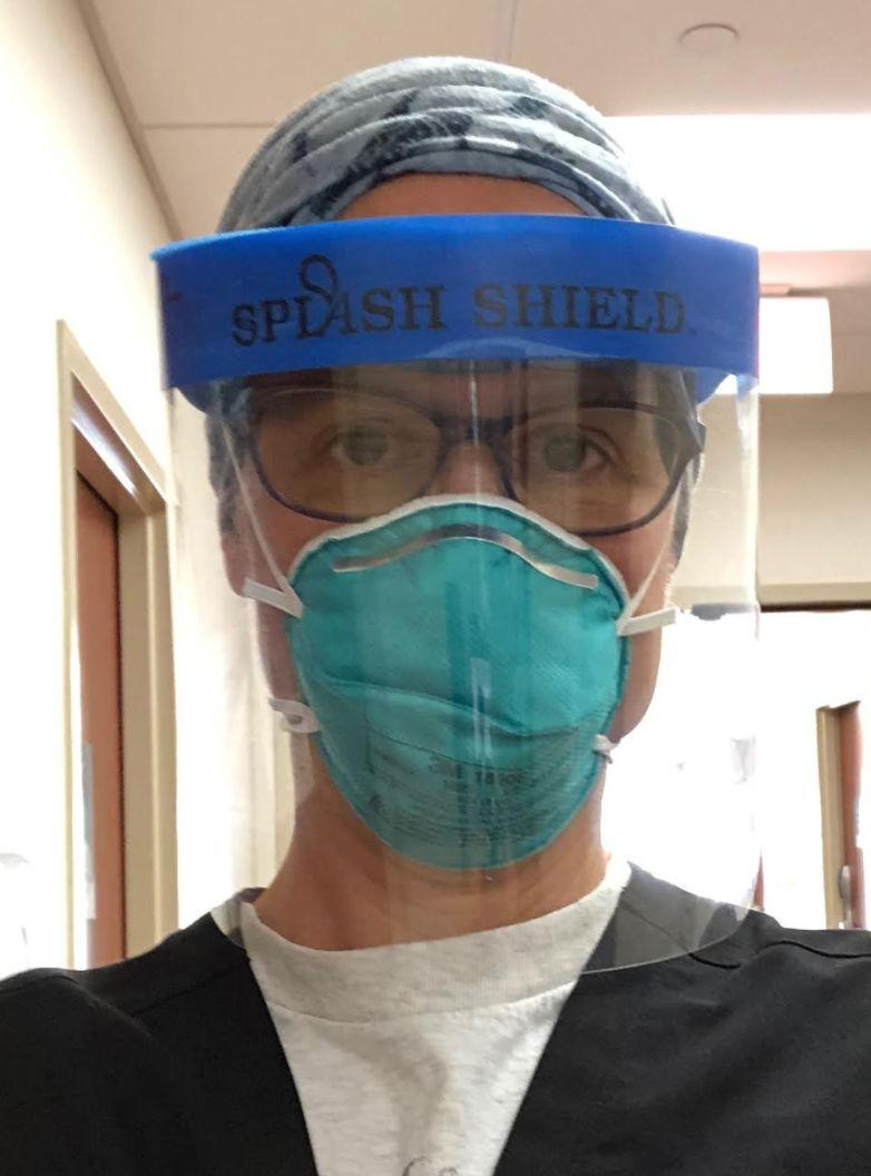 The author, shown wearing protective gear, returned to work in the emergency department of her hospital on July 3, 2020. (Photo: Courtesy of Christine Zink)