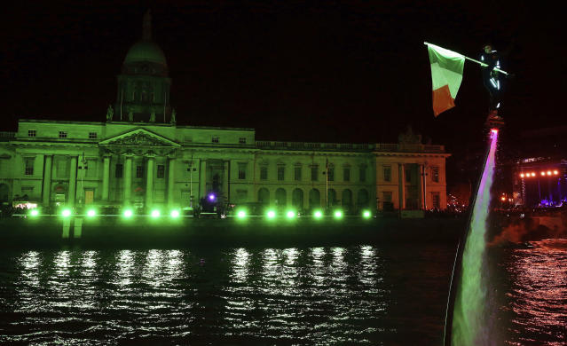 <p>Members of Flyboard Ireland take part in the Liffey Lights Moment – Matinee in Dublin's city centre as part of the city's New Year's eve celebrations, Sunday Dec. 31, 2017. (Photo: Brian Lawless/AP) </p>
