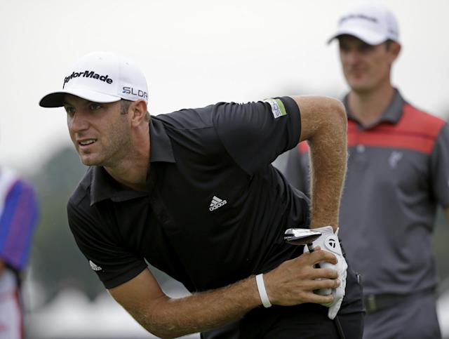 Dustin Johnson, left, watches his tee shot off the seventh hole as Justin Rose, of England, right, waits his turn during the third round of play in the Tour Championship golf tournament at East Lake Golf Club, in Atlanta, Saturday, Sept. 21, 2013. (AP Photo/David Goldman)