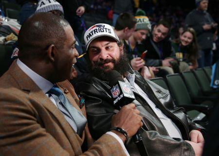 Jan 29, 2018; St. Paul, MN, USA; New England Patriots defensive coordinator Matt Patricia (right) is interviewed by Deion Sanders (left) during Super Bowl LII Opening Night at Xcel Energy Center. Brad Rempel-USA TODAY Sports