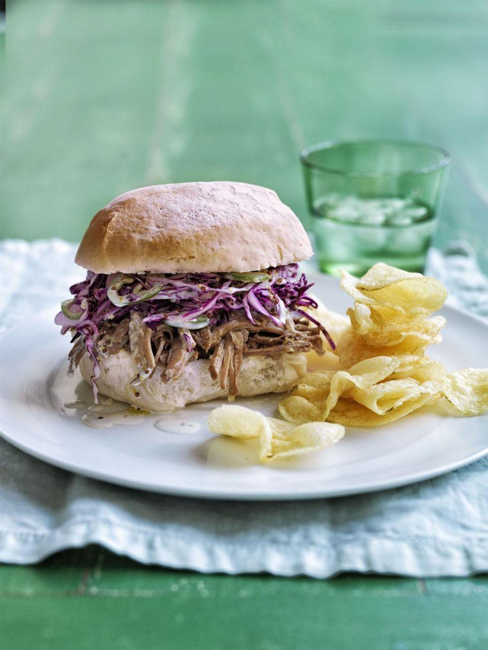 """<p>If you're in the mood for some North Carolina-style BBQ, these juicy pork sandwiches will satisfy those tastebuds. The secret is in the sauce: a mix of cider vinegar, brown sugar, red pepper, and salt. Chop up some cabbage and jalapeño for your slaw and you've got a refreshing, yet delightfully spicy topping. </p><p><em><a href=""""https://www.womansday.com/food-recipes/food-drinks/recipes/a54830/zesty-pork-and-slaw-sandwiches-recipe/"""" rel=""""nofollow noopener"""" target=""""_blank"""" data-ylk=""""slk:Get the recipe from Woman's Day »"""" class=""""link rapid-noclick-resp"""">Get the recipe from Woman's Day »</a></em></p>"""