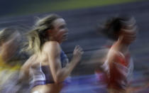 Hanna Green of the United States, left, and China's Wang Chunyu compete during the women's 800 meters heats at the World Athletics Championships in Doha, Qatar, Friday, Sept. 27, 2019. (AP Photo/Petr David Josek)