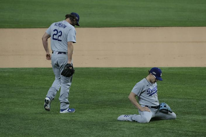 Dodgers pitcher Clayton Kershaw and shortstop Kike Hernandez can't make a play on an infield single.