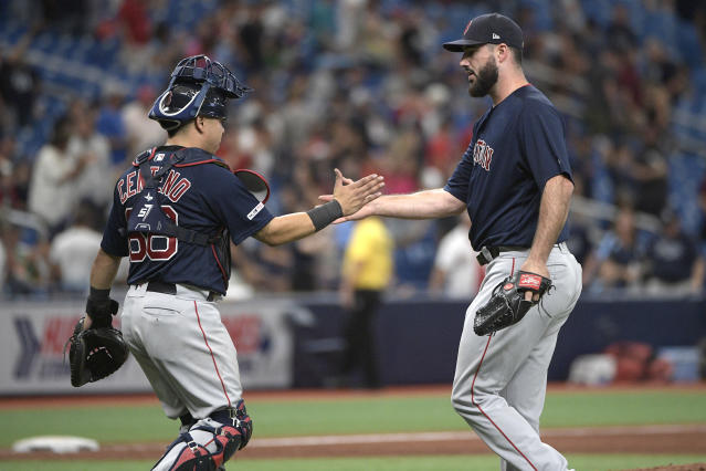Boston Red Sox relief pitcher Brandon Workman, right, is congratulated by catcher Juan Centeno (68) after getting the save in a baseball game against the Tampa Bay Rays Sunday, Sept. 22, 2019, in St. Petersburg, Fla. (AP Photo/Phelan M. Ebenhack)