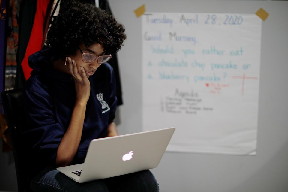 Boston Public School teacher Princess Bryant teaches her kindergarten class via video-conference from her apartment after schools were closed for the remainder of the school year because of the coronavirus outbreak April 28, 2020.  (REUTERS/Brian Snyder)