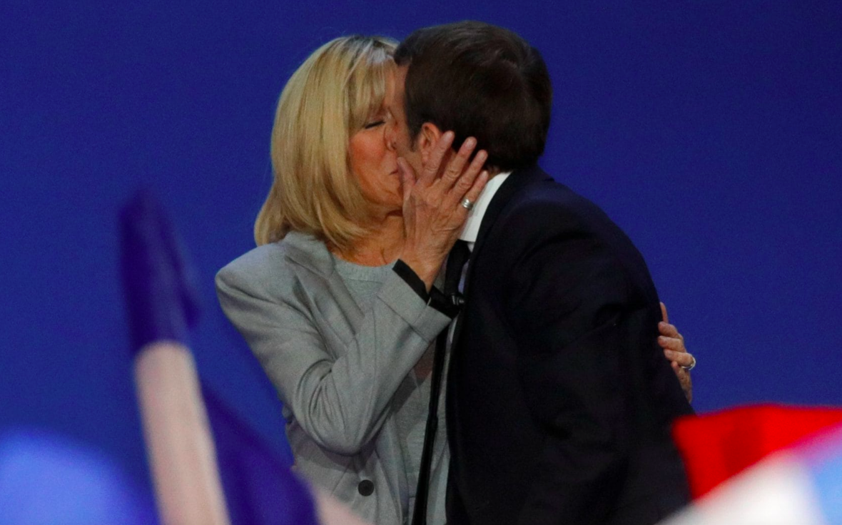 """<p>The couple didn't exactly have a conventional courtship, having met when Emmanuel was a 15-year-old school boy and Brigitte, a married mother-of-three.<br />Although Brigitte was never assigned as his teacher, she was in charge of the high school drama club when Macron joined. They got to know each other when a then 16-year-old Emmanuel suggested they write a play together.<br />Macron was just 17 when he declared his intention to marry Brigitte, but his parents were concerned about the budding relationship and sent him away for his last year of high school.<br />""""You cannot get rid of me. I will come back and I will marry you,"""" Macron told Trogneux according to his biographers.<br />Brigitte eventually divorced her banker husband and joined Macron in Paris. """"Little by little, I came totally under the spell of the intelligence of this young boy,"""" Trogneux told France 3 TV.<br />And proving their doubters wrong, the couple went on to marry in 2007. Aww. <em>[Photo: Reuters]</em> </p>"""