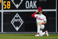 Philadelphia Phillies right fielder Bryce Harper adjusts his hat during the fourth inning of an interleague baseball game against the Baltimore Orioles, Tuesday, Sept. 21, 2021, in Philadelphia. (AP Photo/Matt Slocum)