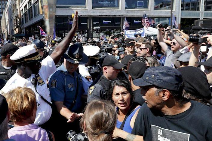Cleveland Police Chief Calvin Williams, left, talks with protesters on Wednesday. (Photo: Alex Brandon/AP)