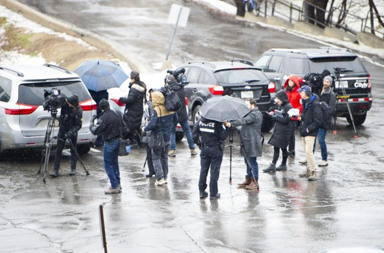 Journalist gather at Saint Joseph's Oratory in Montreal on March 22, 2019, after Catholic priest Claude Grou was stabbed