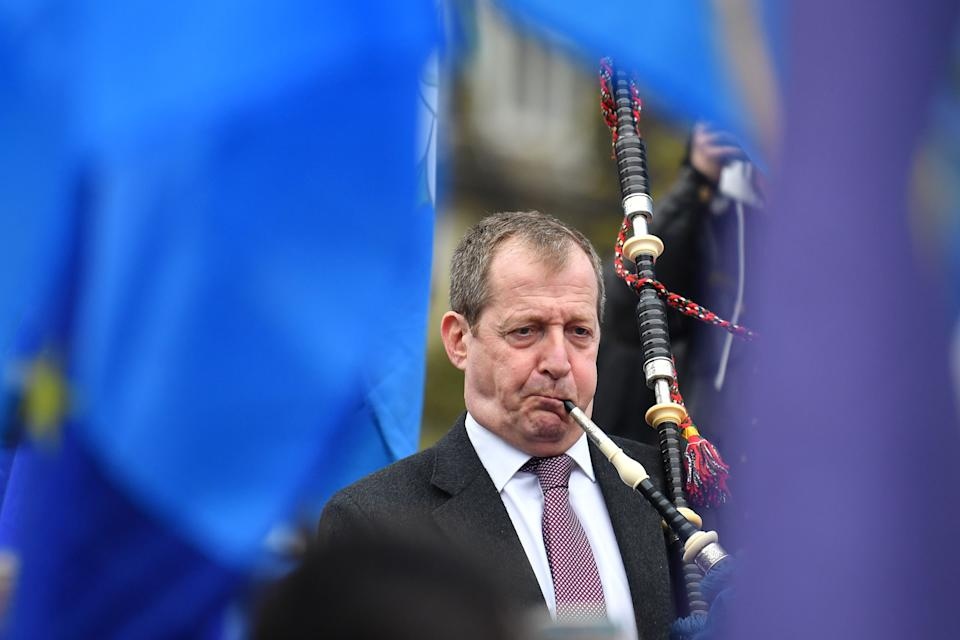 Alastair Campbell, former director of communications for Tony Blair plays the bagpipes as he demonstrates outside the Houses of Parliament in central London on April 8, 2019. - British Prime Minister Theresa May will meet with German and French leaders Angela Merkel and Emmanuel Macron as she scrambles to find a Brexit breakthrough ahead of Wednesday's crucial EU summit. (Photo by Ben STANSALL / AFP) (Photo by BEN STANSALL/AFP via Getty Images)