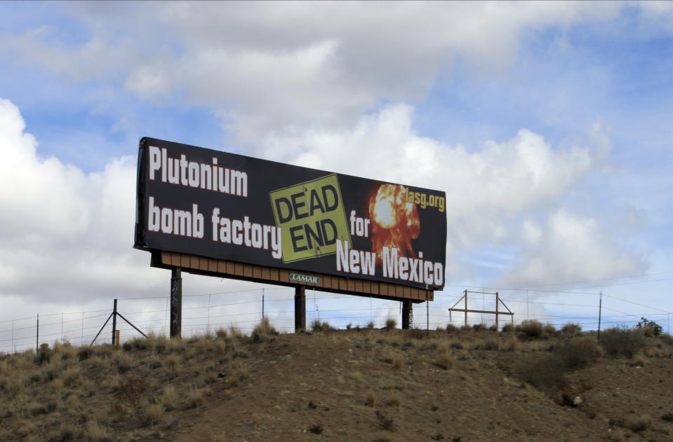 The Los Alamos Study Group takes aim at the U.S. government's plans to ramp up production of plutonium cores for the nation's nuclear arsenal with this billboard near Bernalillo, N.M., Wednesday, Feb. 17, 2021. The work will be split between Los Alamos National Laboratory in northern New Mexico and the Savannah River Site in South Carolina. (AP Photo/Susan Montoya Bryan)