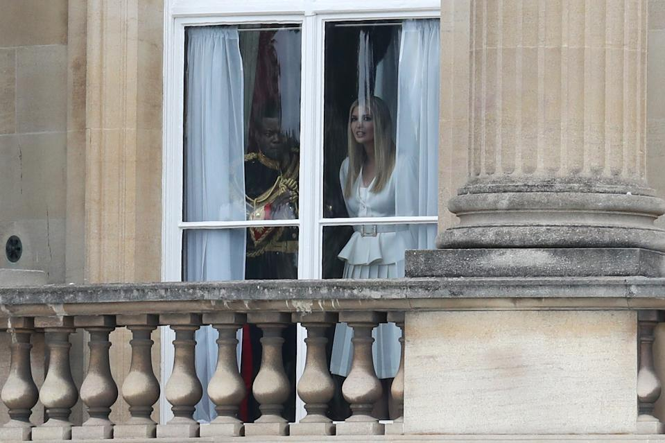 Taking in the sights: President Trump's daughter Ivanka looks out of a window at Buckingham Palace as the First family made themselves at home in London. (Chris Jackson/Getty Images)