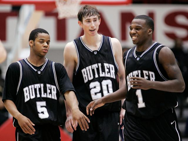 Ronald Nored (5), Gordon Hayward (20) and Shelvin Mack (1) celebrate a Butler win during the 2009 college basketball season. (AP file photo)