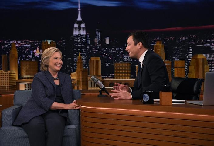 """US Democratic presidential nominee Hillary Clinton speaks with talk show host Jimmy Fallon as she attends the taping of """"The Tonight Show"""" in New York, on September 16, 2016 (AFP Photo/Timothy A. Clary)"""