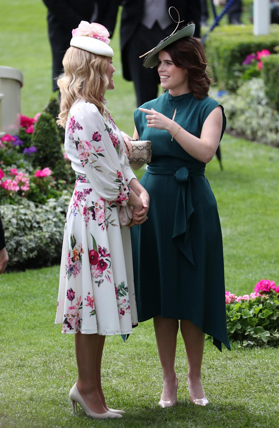 """Princess Eugenie wore Samantha Cameron's brand <a href=""""https://www.cefinn.com/uk/dresses/silk-asymmetric-hem-midi-dress-with-keyhole-teal"""" rel=""""nofollow noopener"""" target=""""_blank"""" data-ylk=""""slk:Cefinn"""" class=""""link rapid-noclick-resp"""">Cefinn</a> - their Mia silk asymmetric hem midi dress with keyhold detailing with a feathered hat by Bundle MacLaren Millinery, nude courts and a snakeskin clutch. <em>[Photo: PA]</em>"""