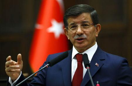 Turkey's Prime Minister Davutoglu addresses members of parliament from his ruling AK Party at the Turkish parliament in Ankara