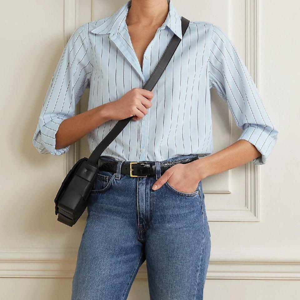 """Would this gallery *really* be complete with a pinstripe shirt? It would not, which is why we pulled this minimalist dress shirt as a reminder that it can be worn with everything from straight-leg denim to <a href=""""https://www.glamour.com/gallery/best-black-leggings-to-buy-now?mbid=synd_yahoo_rss"""" rel=""""nofollow noopener"""" target=""""_blank"""" data-ylk=""""slk:black leggings"""" class=""""link rapid-noclick-resp"""">black leggings</a>. You're welcome. $295, Net-a-Porter. <a href=""""https://www.net-a-porter.com/en-us/shop/product/nili-lotan/clothing/shirts/libby-striped-cotton-shirt/6630340699279909"""" rel=""""nofollow noopener"""" target=""""_blank"""" data-ylk=""""slk:Get it now!"""" class=""""link rapid-noclick-resp"""">Get it now!</a>"""