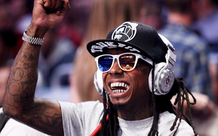 Rapper Lil Wayne, who supported Trump's reelection bid, is also reportedly in line for a pardon - Jeff Haynes/Reuters