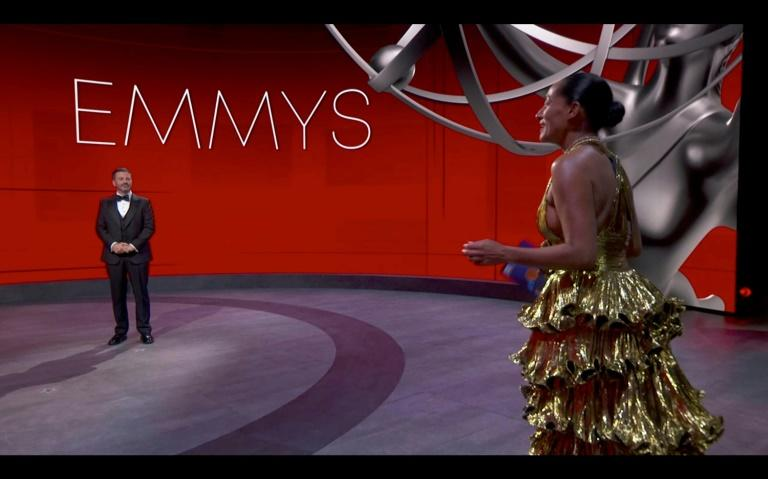 Tracee Ellis Ross (R), one of the few stars on the Emmys stage with host Jimmy Kimmel, oozed glamour in her gold Alexandre Vauthier gown, but many other stars were more casual