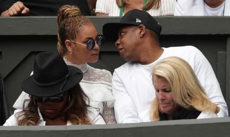 Britain Tennis - Wimbledon - All England Lawn Tennis & Croquet Club, Wimbledon, England - 9/7/16 Singer Beyonce with her husband musician Jay Z with USA's Serena Williams' family and friends on centre court during the womens singles final REUTERS/Adam Davy/Pool