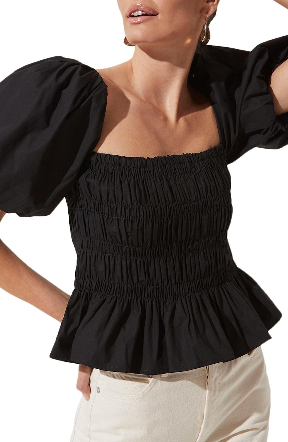 <p>We love the crisp look and flouncy silhouette of this <span>ASTR the Label Bubble Sleeve Smocked Blouse</span> ($65).</p>