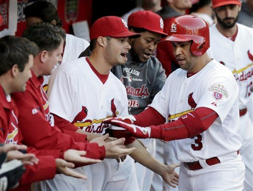 St. Louis Cardinals' Carlos Beltran (3) celebrates in the dugout after hitting a solo home run during the sixth inning of Game 2 of the National League division baseball series against the Washington Nationals, Monday, Oct. 8, 2012, in St. Louis. (AP Photo/Charlie Riedel)