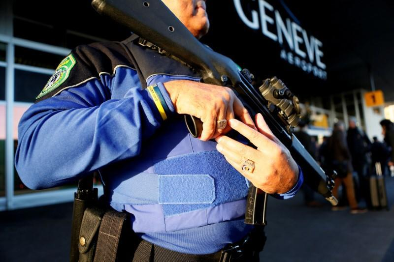 FILE PHOTO: County of Geneva police officer stands guard outside Cointrin airport in Geneva
