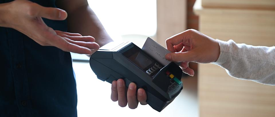 Woman paying with credit card in