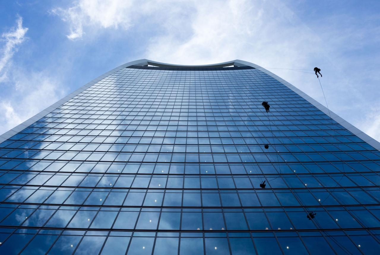 <p>Workers inspect the Walkie-Talkie skyscraper in London (Rex features) </p>