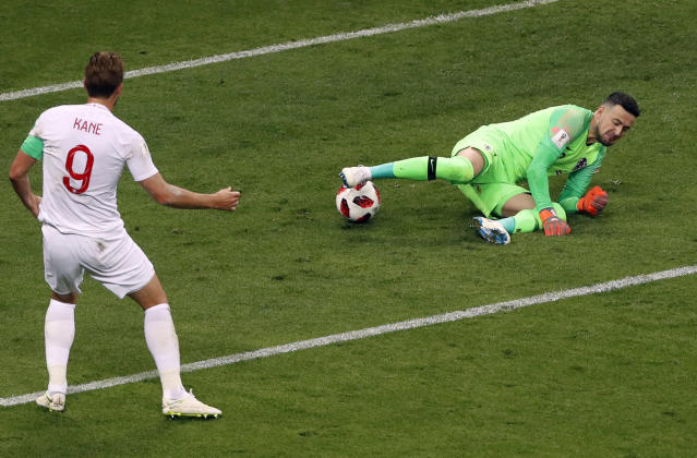 Croatia goalkeeper Danijel Subasic, right, makes a save in front of England's Harry Kane during the semifinal match between Croatia and England at the 2018 soccer World Cup in the Luzhniki Stadium in Moscow, Russia, Wednesday, July 11, 2018. (AP Photo/Darko Bandic)