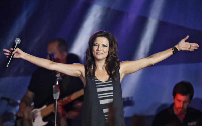 "FILE - This June 8, 2013 file photo shows country singer Martina McBride performing at the Rays Summer Concert Series after a baseball game between the Tampa Bay Rays and the Baltimore Orioles in St. Petersburg, Fla. McBride, known for her huge soprano voice, is self-releasing ""Everlasting,"" on March 4, a new album of classic soul and R&B songs made famous by the likes of Franklin and James, but also Elvis and Van Morrison and more. (AP Photo/Chris O'Meara, File)"