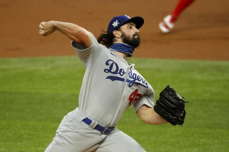 Los Angeles Dodgers starting pitcher Tony Gonsolin throws during the first inning of a baseball game against the Texas Rangers in Arlington, Texas, Sunday, Aug. 30, 2020. (AP Photo/Roger Steinman)