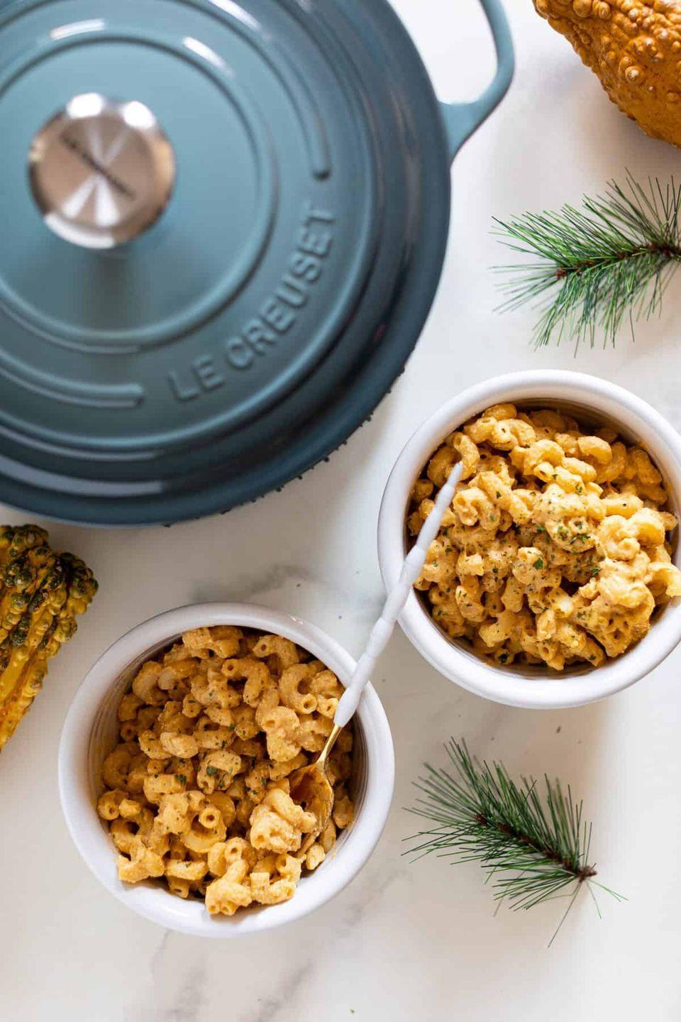 """<p>When you have a craving for comfort food, this healthy version of mac and cheese will hit the spot. A creamy pumpkin sauce with cajun seasoning takes the place of cheese—but you won't miss a thing!</p><p><strong>Get the recipe at <a href=""""https://www.orchidsandsweettea.com/easy-vegan-pumpkin-mac-cheese/"""" rel=""""nofollow noopener"""" target=""""_blank"""" data-ylk=""""slk:Orchids + Sweet Tea"""" class=""""link rapid-noclick-resp"""">Orchids + Sweet Tea</a>. </strong></p><p><a class=""""link rapid-noclick-resp"""" href=""""https://go.redirectingat.com?id=74968X1596630&url=https%3A%2F%2Fwww.walmart.com%2Fsearch%2F%3Fquery%3Dpioneer%2Bwoman%2Bpots&sref=https%3A%2F%2Fwww.thepioneerwoman.com%2Ffood-cooking%2Fmeals-menus%2Fg37022645%2Fhealthy-pumpkin-recipes%2F"""" rel=""""nofollow noopener"""" target=""""_blank"""" data-ylk=""""slk:SHOP POTS"""">SHOP POTS</a></p>"""