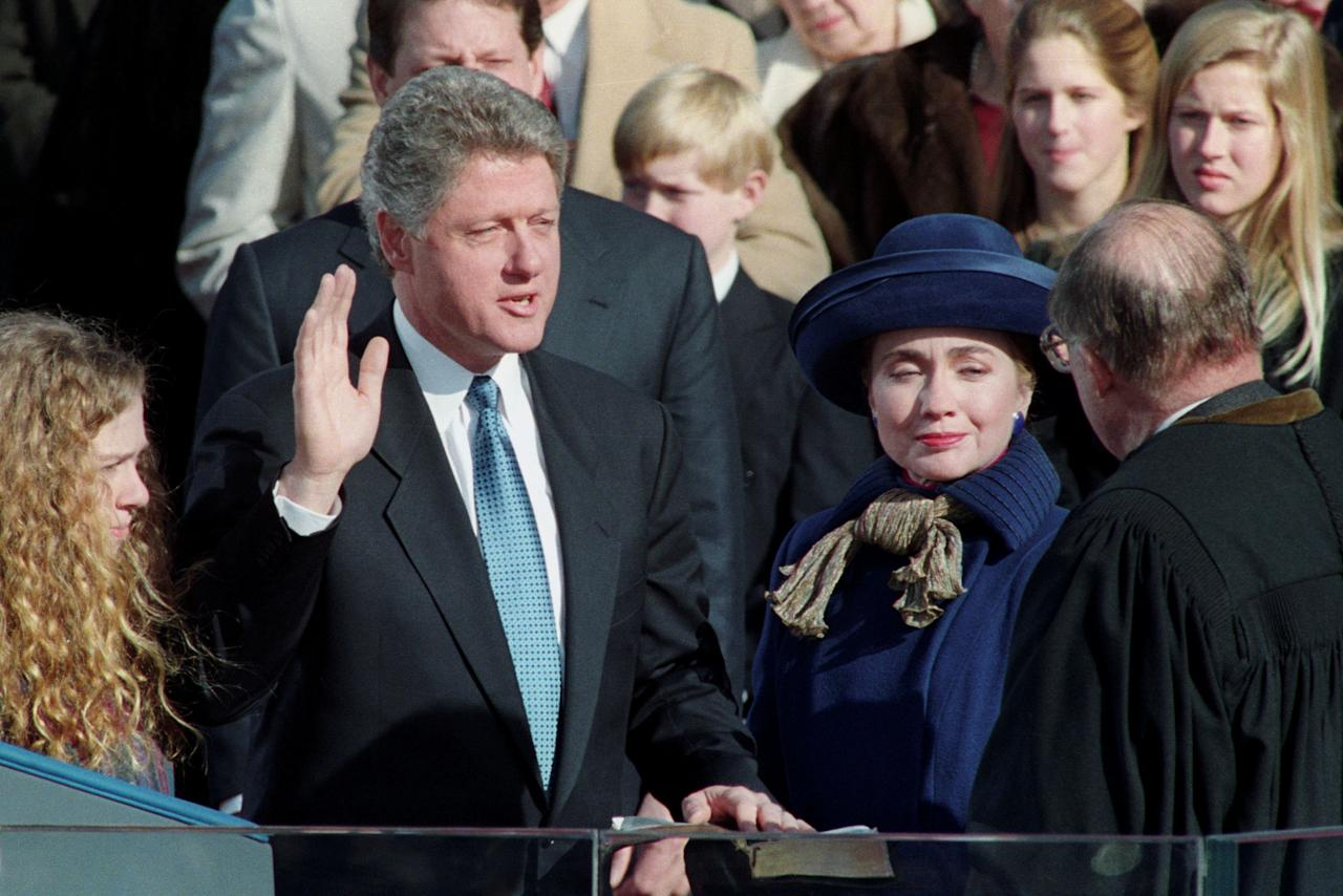 Bill Clinton is sworn-in as the 42nd President of the United States by U.S. Chief of Justice Honorable William H. Rehnquist (R) as his wife Hillary and his daughter Chelsea (L) look on in Washington, DC on January 20, 1993.  REUTERS/Jim Bourg