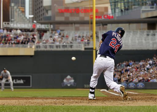 Minnesota Twins' Trevor Plouffe (24) hits a two-run double against Chicago White Sox starting pitcher Hector Santiago during the third inning of a baseball game, Monday, May 13, 2013, in Minneapolis. (AP Photo/Genevieve Ross)