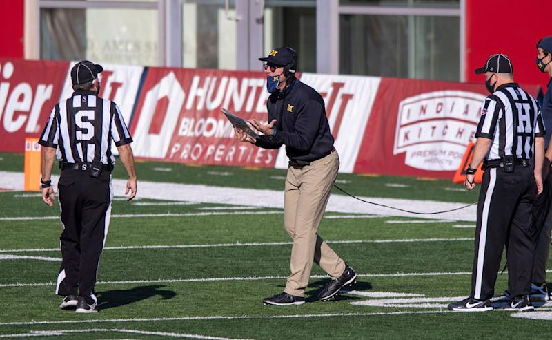 Jim Harbaugh reacts towards an official after a call during the second half vs. Indiana.