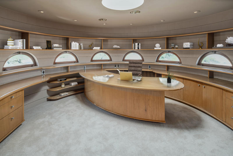 """This undated photo provided by Heritage Auctions in September 2019 shows a home in Phoenix designed by architect Frank Lloyd Wright. The Norman Lykes House will be up for auction in October 2019. Wright designed the home, nicknamed the """"Circular Sun House"""" before his death in 1959. (Heritage Auctions via AP)"""