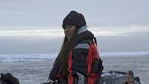 Environmental activist and campaigner Mya-Rose Craig sits on a boat in the middle of the Arctic Ocean